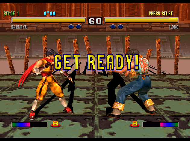 Two masculine figures stand facing each other in an arena with their health bars displayed at the top of the screen. The words 'Get ready' are depicted over them.