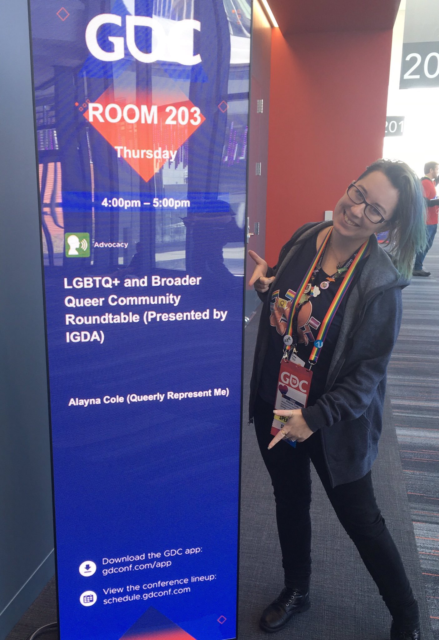 Photo of Alayna Cole next to sign announcing the GDC 2019 roundtable