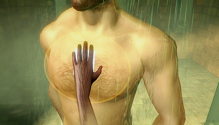 A hand reaches out and cleans a masculine torso in a shower.