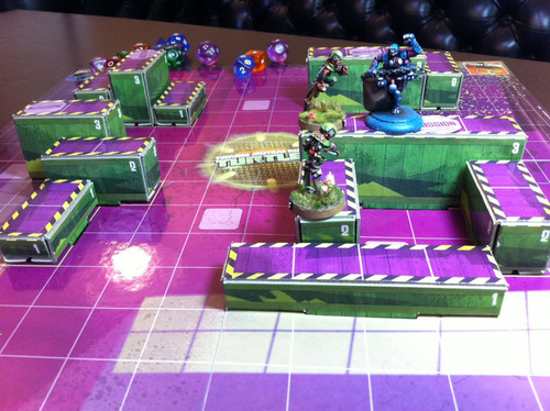 A series of platforms with some characters standing on them, on a playing field with several dice.
