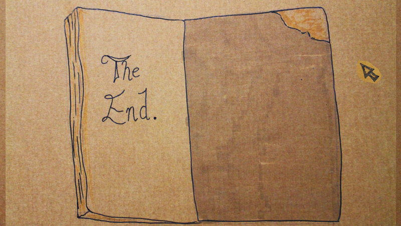 Book drawn on cardboard reads 'The End'
