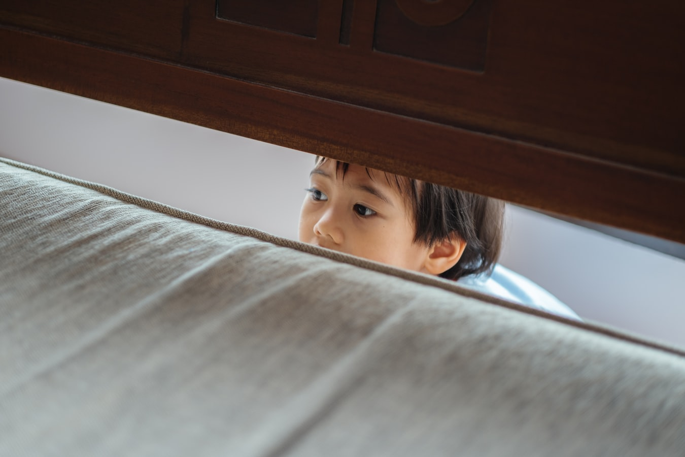 A person looking through a small gap.